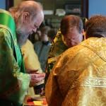 Bishop Alexander Golitzin prepares the Gifts just before Communion