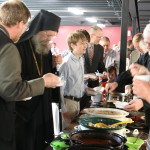 Bishop Alexander samples various chilis prepared by the youth for the Annual Tongues of Fire Cookoff after the Liturgy