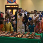 Fr. Cosmin blesses the icons the kids prepared as part of Vacation Church School 2016